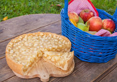 Fresh  apple pie and fruits on wooden table Royalty Free Stock Image