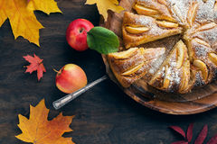Fresh baked apple pie on the woden table witn autumn leaves arou Stock Images