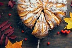 Fresh baked apple pie on the woden table witn autumn leaves arou Royalty Free Stock Photos