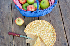 Fresh baked apple pie on wooden table Royalty Free Stock Photos
