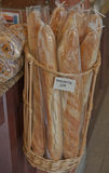 Fresh-Baked Baguettes--Jean-Talon Market, Montreal, Canada. Fresh-baked baguettes on display in a wicker basket in the large public Jean-Talon market in Montreal Royalty Free Stock Image