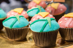 Fresh baked blue and pink cupcakes Royalty Free Stock Image