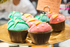 Fresh baked blue and pink cupcakes Stock Photo