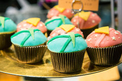Fresh baked blue and pink cupcakes Stock Image