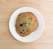 Fresh baked blueberry muffin top on a white plate Royalty Free Stock Photography