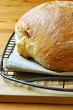 Fresh-baked Bread. Fresh-baked loaf of bread on cooling rack Royalty Free Stock Photography