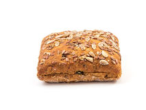 Fresh baked bread or bun with sesame and sunflower seeds topping Royalty Free Stock Image
