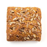 Fresh baked bread or bun with sesame and sunflower seeds topping Royalty Free Stock Photos