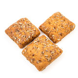 Fresh baked bread or bun with sesame and sunflower seeds topping Stock Photography
