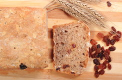 Fresh baked bread, ears of wheat and raisins Stock Image