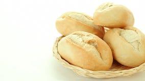 Fresh baked bread rolls in basket stock footage