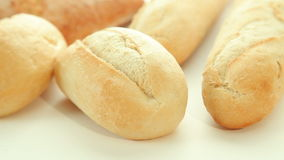 Fresh baked bread rolls stock video footage