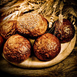 Fresh baked bread with wheat Royalty Free Stock Images
