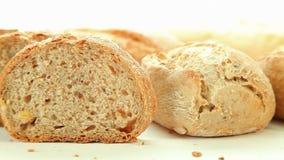 Fresh baked bread on white background stock video
