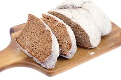 Fresh baked bread with white crust, sprinkled with flour Stock Photography