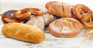 Fresh baked bread on a white wooden table stock photos