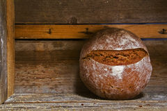 Fresh baked bread at wooden shelf Stock Images