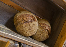Fresh baked bread at wooden shelf Royalty Free Stock Image
