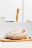 Fresh baked bread on wooden table. soft light Stock Images