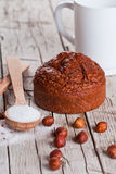 Fresh baked browny cake, milk, sugar, hazelnuts Stock Images
