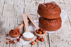 Fresh baked browny cakes, milk, sugar, hazelnuts and cocoa powde Stock Photos