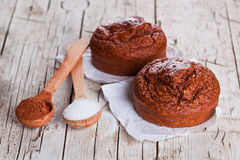 Fresh baked browny cakes, sugar and cocoa powder Royalty Free Stock Photo