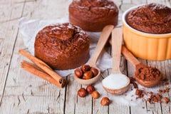 Fresh Baked Browny Cakes, Sugar, Hazelnuts And Cocoa Powder Stock Photos