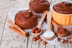 Fresh baked browny cakes, sugar, hazelnuts and cocoa powder Stock Photos