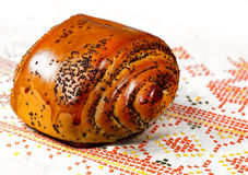 Fresh baked  bun with poppy-seed Royalty Free Stock Images