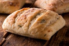 Cheddar Jalapeno Ciabatta. Fresh baked cheddar jalapeno ciabatta on a rustic wood board Royalty Free Stock Photos