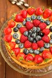 Fresh baked cheesecake with strawberries, raspberries and blueberries. Home baked cheesecake Stock Image