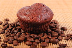 Fresh baked chocolate muffins and coffee grains Royalty Free Stock Photo