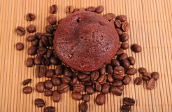 Fresh baked chocolate muffins and coffee grains Royalty Free Stock Image