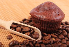 Fresh baked chocolate muffins and coffee grains Royalty Free Stock Images