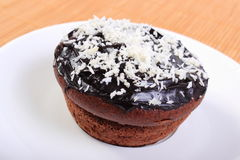 Fresh baked chocolate muffins with desiccated coconut Stock Image