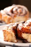 Fresh baked cinnamon buns with icing Royalty Free Stock Photography