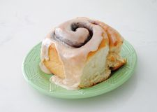 Fresh Baked Cinnamon Roll with Maple Glaze. Fresh Baked Cinnamon Roll with Maple Icing for a delicious breakfast Stock Photo