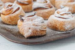 Fresh baked cinnamon rolls on steel baking tray Stock Photos