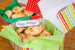 Fresh baked coconut macaroons with seasons greeting tag. Stock Photos