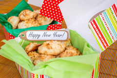 Fresh baked coconut macaroons with seasons greeting tag. Stock Images