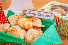 Fresh baked coconut macaroons with seasons greeting tag. Stock Photo