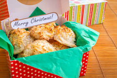 Fresh baked coconut macaroons with seasons greeting tag. Stock Image