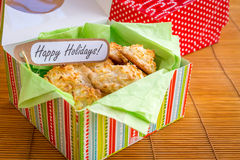 Fresh baked coconut macaroons with seasons greeting tag. Stock Photography