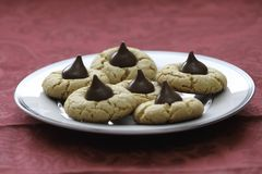 Homemade peanut butter and chocolate drop cookies. Fresh baked cookies. close up showing texture. Plate on table with red tablecloth Stock Images