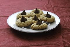 Homemade peanut butter and chocolate drop cookies. Fresh baked cookies. close up showing texture. Plate on table with red tablecloth stock photos