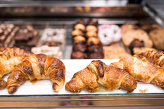 Fresh baked croissant pastry on sale in cafe.Empty price tag frames.Buy tasty bakery product for coffee break.Sweet Royalty Free Stock Photo