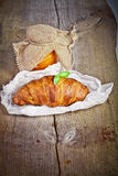 Fresh baked croissants with apricot jam Royalty Free Stock Photo