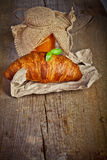 Fresh baked croissants with apricot jam Royalty Free Stock Photos