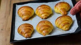 Fresh baked croissants on baking sheet. HD stock video footage