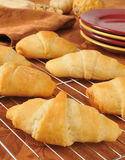 Fresh baked croissants on a holiday table Stock Images